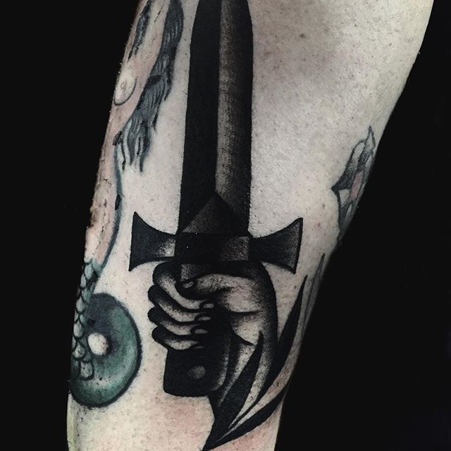 Sword tattoo, blackwork